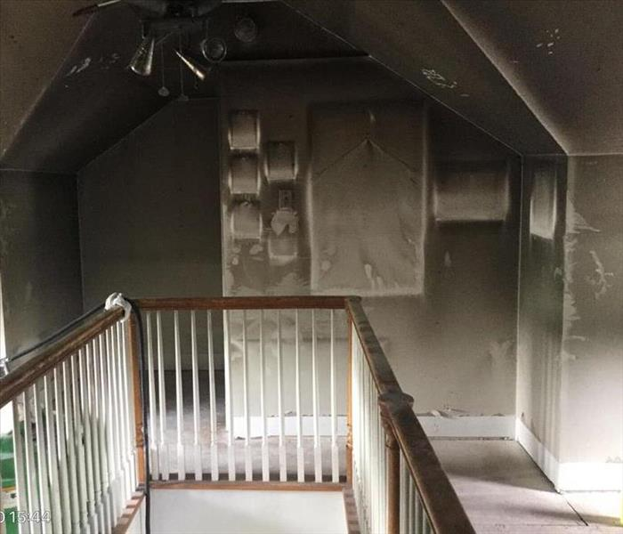 Soot damage outlined by picture frames