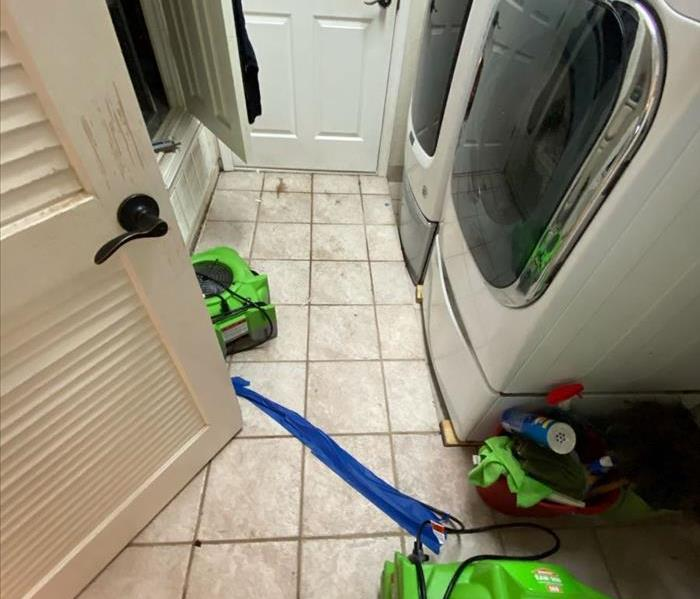 washing machine and dryer with fan on the floor